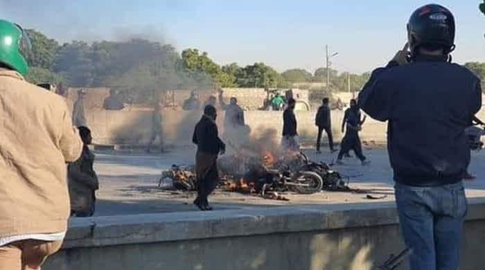 Motorbikes set on fire as commuters lose temper on blocked bridge