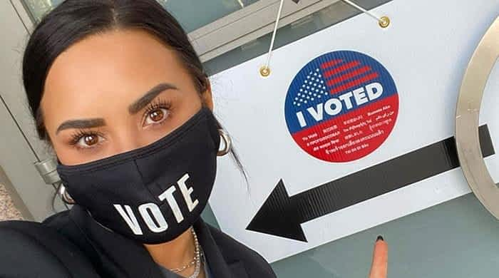Max Ehrich's ex Demi Lovato urges fans to vote, says 'nothing will change unless you take action'